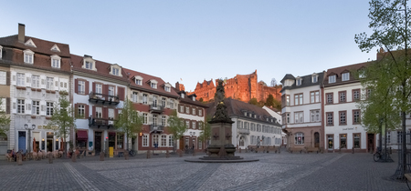 Heidelberg, Germany - April 20, 2015: Schloss oberhalb der Altstadt. The view from the old town to the castle in the late evening light almost at sunset