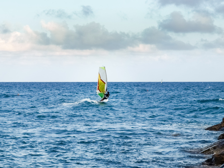 Oneglia, Italy - June 14, 2015: Windsurfing in the evening light