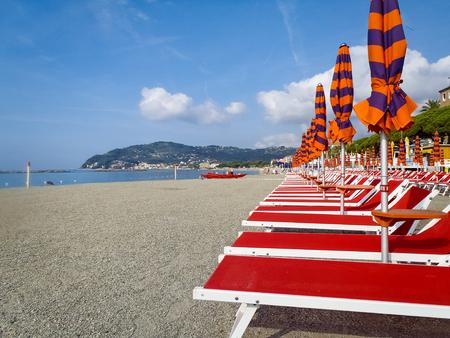 Diano Marina, Italy: Beach umbrellas positioned at regular file Zdjęcie Seryjne