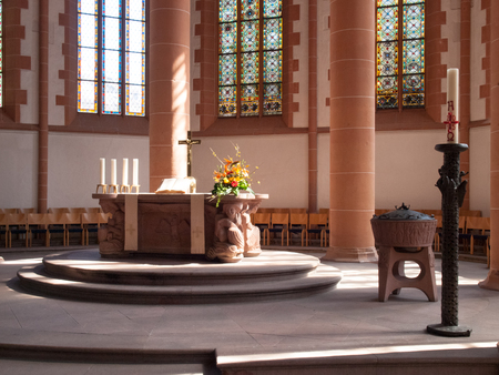 Heidelberg, Germany - April 20, 2015: HeiliggeistKirche, Altar illuminated by natural light coming from, a window on the side wall. The light creates a soft and delicate Publikacyjne