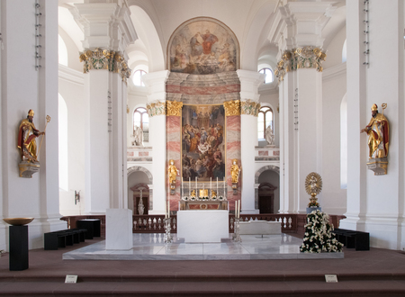 Heidelberg, Germany - April 20, 2015: JesuitenKirche, Altar illuminated by natural light coming from, a window on the side wall. The light creates a soft and delicate