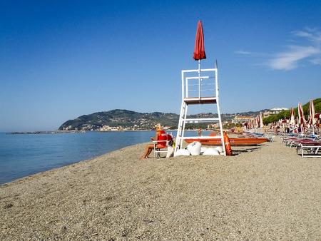 San Bartolomeo, Italy - June 18, 2015: Lifeguard on the beach looking bathers