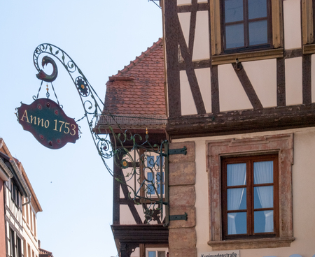 Neustadt an der Weinstrasse, Germany - April 19, 2015: Coat of Arms of professions exposed on the wall of the building. SI is a typical traditional finish of the Germanic countries