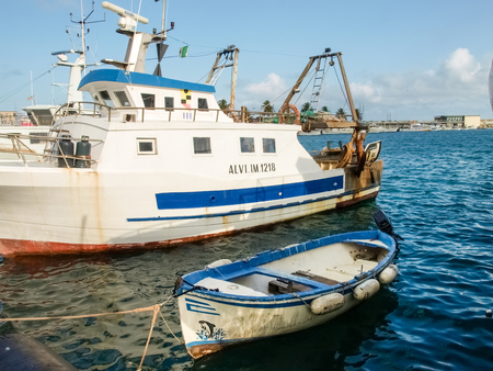 Oneglia, Italy - June 14, 2015: Marina and fishing. Several fishing boats are moored. In the background the buildings typical of Oneglia. Publikacyjne