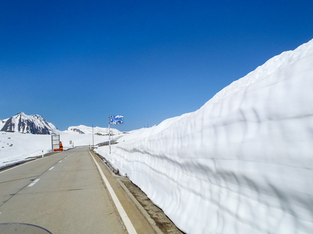 Switzerland: Pass road of Nufenen-Novena, Last remnants of snow after the winter season. Stock Photo