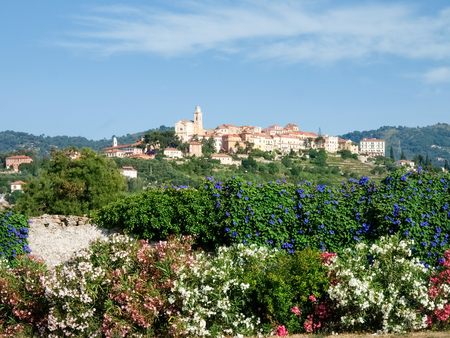 Diano Castello, Italy - June 18, 2015: Hilltop village surrounded by olive groves and vineyards