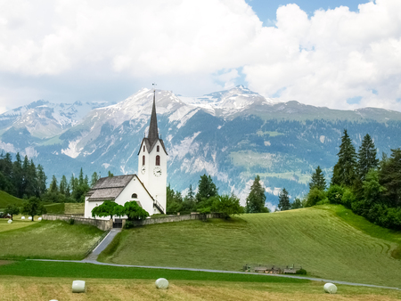 Graubuenden, Switzerland - June 4, 2015: Urserental. Church of the village of Versam, the resort town of Safiental in the Canton of Grisons. Zdjęcie Seryjne