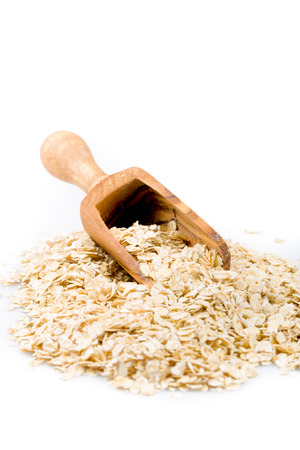 roughage: pile of oatmeal with white background Stock Photo