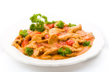 Sliced meat with mushrooms and tomatoes