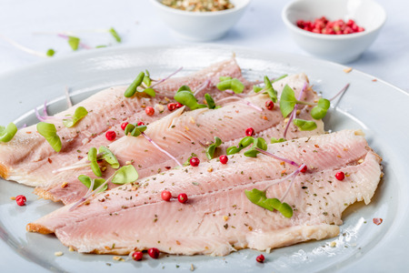 smoked trout fillet with pink pepper and fresh cress Stock Photo