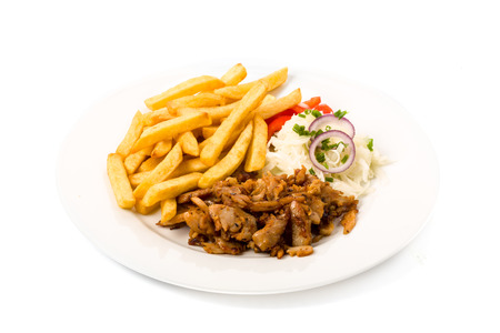 Kebab plate with french fries fresh cole slaw and onions