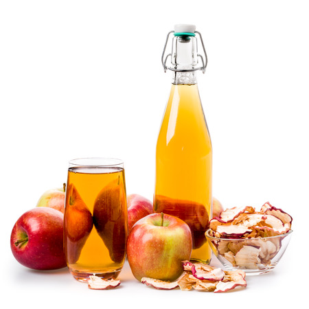 juice bottle: Apple juice and apples with a juice bottle, isolated Stock Photo