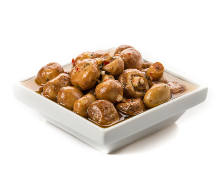 antipasti: Antipasti mushrooms loaded with fresh herbs in oil