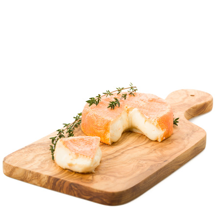 roan: Cut French soft cheese with herbs and roan Stock Photo