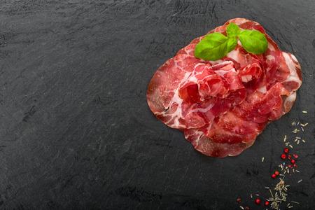 Coppa di Parma ham with fresh basil