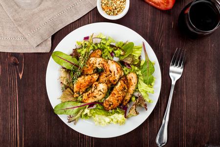 Chicken breast on fresh salad on a background Standard-Bild