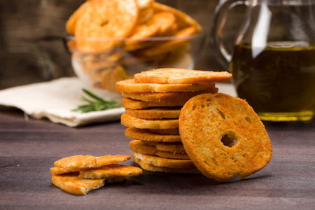 nibble: Bread chips flavored with paprika and rosemary on a background