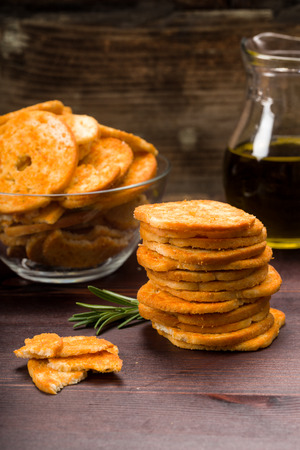 nibbles: Bread chips flavored with paprika and rosemary on a background