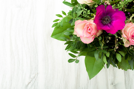 Bouquet, tied on a wooden background photo