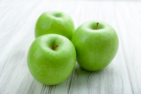 granny smith: Granny Smith apple on a background