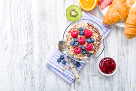 cereals: Muesli with fresh fruit on a breakfast table