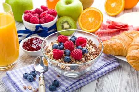 Muesli with fresh fruit on a breakfast table