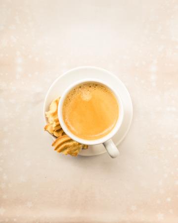 crema: Crema Coffee with biscuits on bright underground