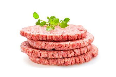 Fresh Burger patties raw on a white underground