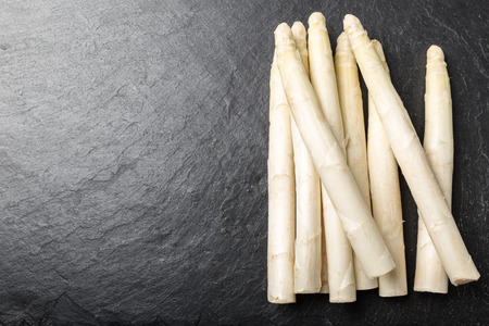 Fresh white asparagus, served on a background