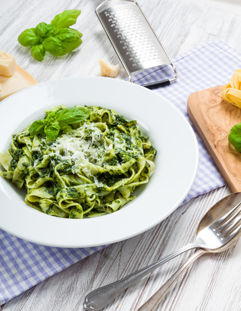 fettuccine: Fettuccine with spinach, Parmesan and fresh basil Stock Photo