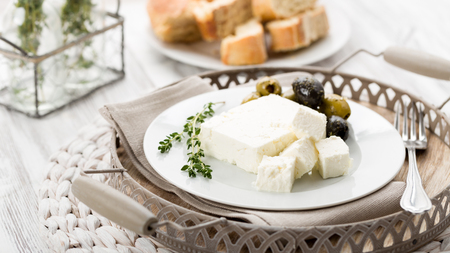 Feta cheese with olives and herbs