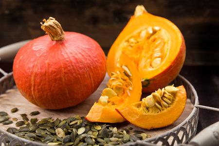 Fresh sliced pumpkin with pumpkin seeds Decorated Stock Photo