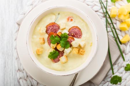 vigorously: Creamy potato soup with hearty sausage and herbs