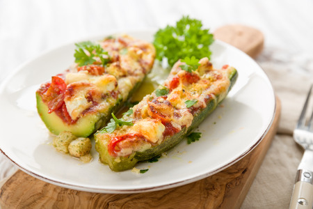 Stuffed Courgettes with tomatoes, feta and parmesan