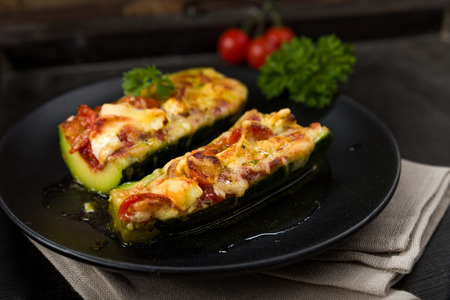 Parmesan: Stuffed Courgettes with tomatoes, feta and parmesan