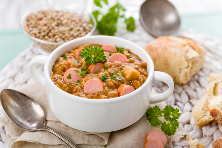 fresh lentil stew with sausages and parsley Standard-Bild