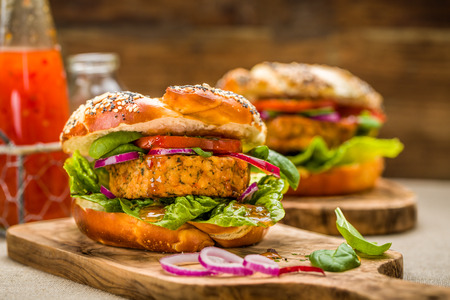 chili sauce: Healthy vegan burger with fresh vegetables and chili sauce Stock Photo