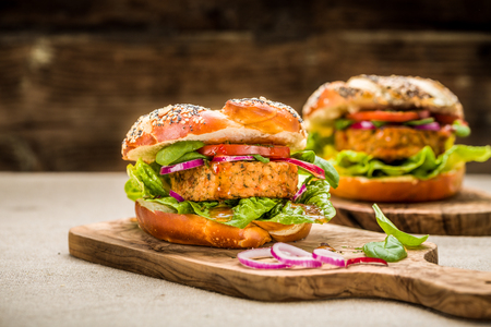Healthy vegan burger with fresh vegetables and chili sauce Stock Photo