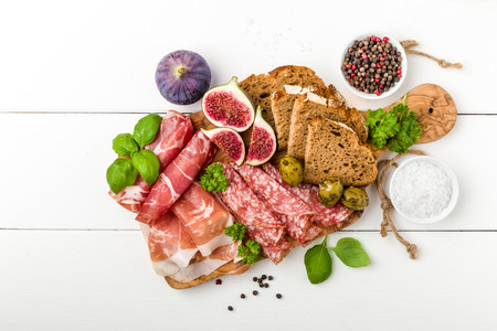 air dried salami: Italian antipasti sausage with figs, olives and fresh herbs