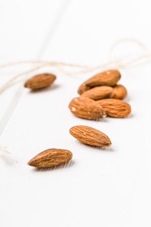 Several almonds on a white background Stock Photo
