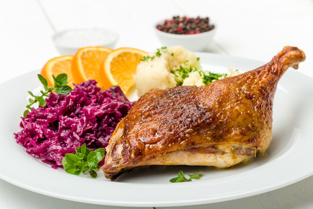 Roast duck with dumplings, red cabbage and oranges
