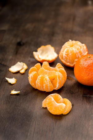 clementines: Fresh Clementines as a whole and as pieces to a background Stock Photo