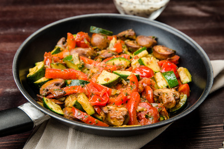 combining: Fried vegetables with fresh vegetables and mushrooms without meat Stock Photo