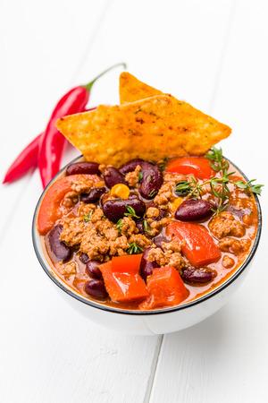 con: Fresh chili con carne with tortilla chips Stock Photo