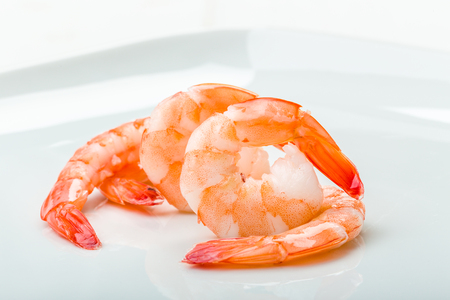 gambas: Gambas draped on a white background Stock Photo
