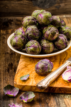 exempted: Fresh Purple Brussels sprouts on a background Stock Photo