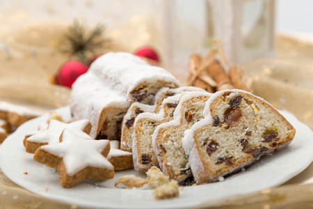 Christmas Stollen sliced on a plate with cinnamon stars