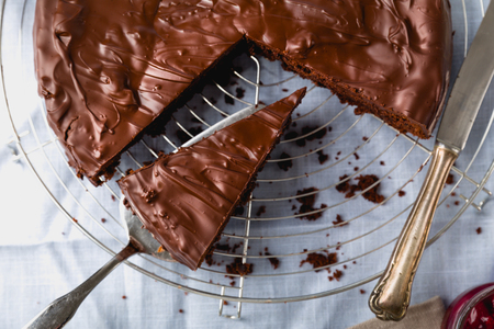 Chocolate cake cut into several pieces with decoration
