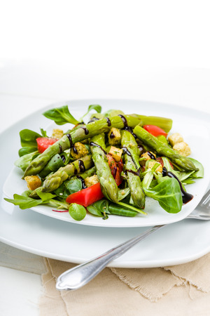 croutons: Asparagus salad with balsamic vinegar, croutons and fresh tomatoes Stock Photo