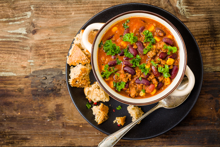 Chili con carne on a wooden background Stock Photo